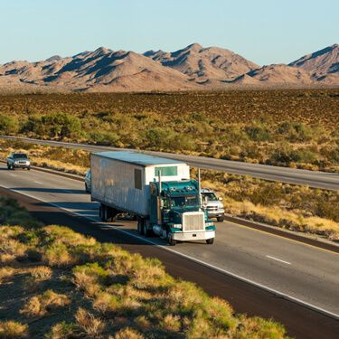 Green Semi Truck Cross Border Freight from or to Arizona