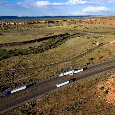Cross Border Shipping from or To New Mexico Aerial view highway with semi trucks