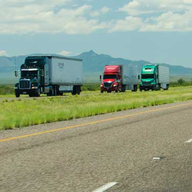 Flatbed truckloads on highway Intra-Mexico Freight Shipping