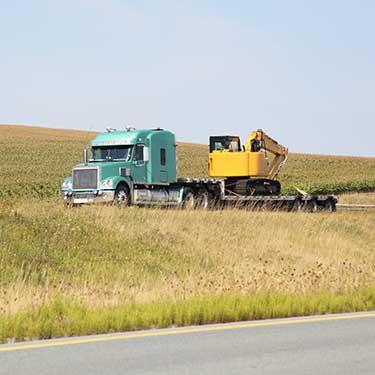 Transporte de maquinaria de pesada cargador frontal